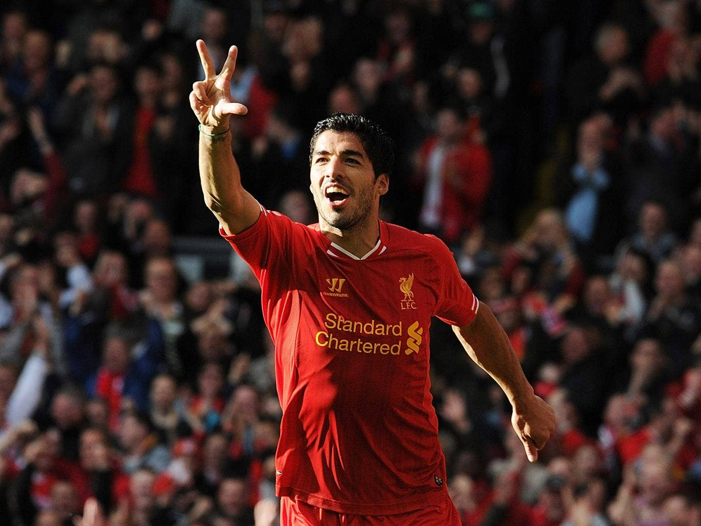 Luis Suarez celebrates his hat-trick for Liverpool against West Brom
