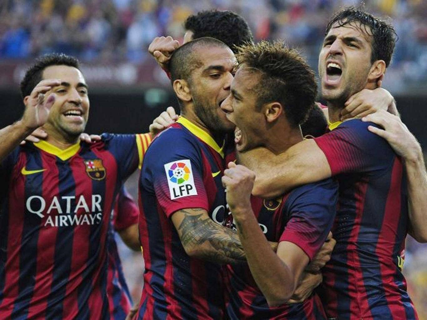 Home hero: Neymar (centre) is congratulated by his Barcelona team-mates but Gareth Bale had a disappointing day for Real Madrid