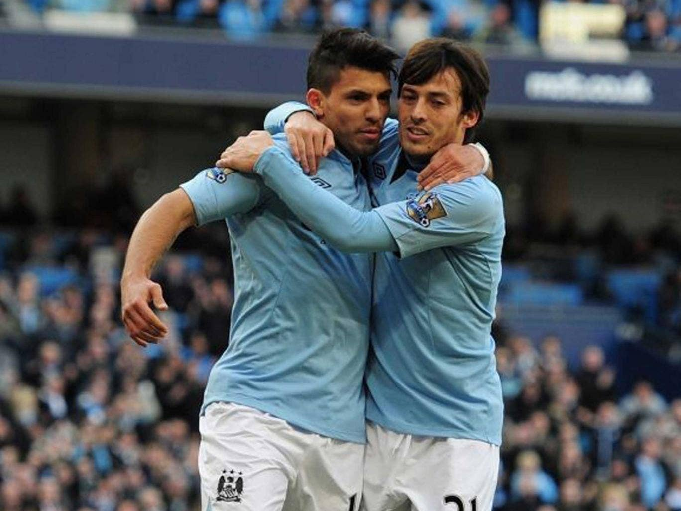 Tight bond: Aguero (left) and Silva have formed a sound understanding