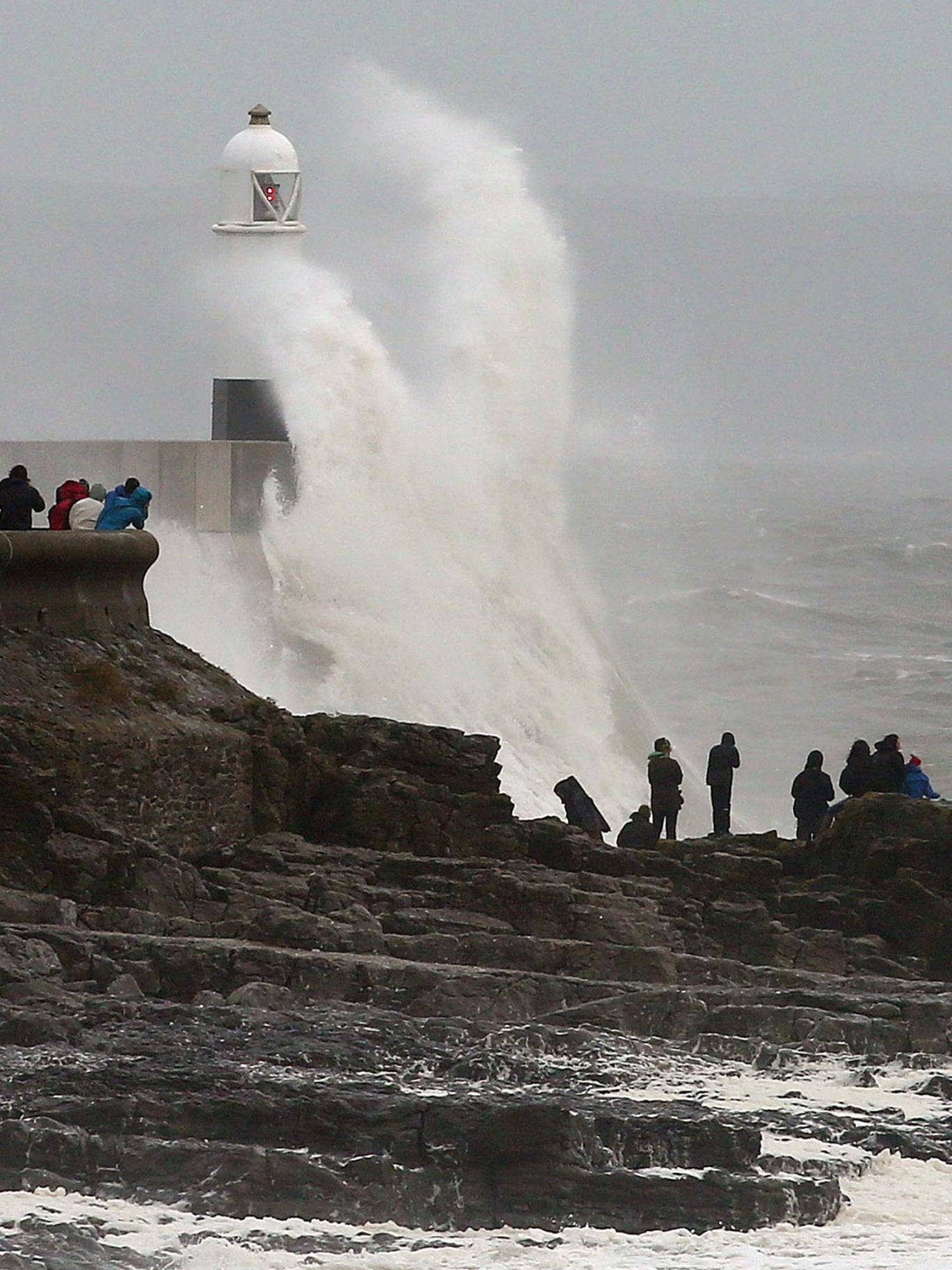 Waves crash against the sea barriers in Porthcawl, south Wales
