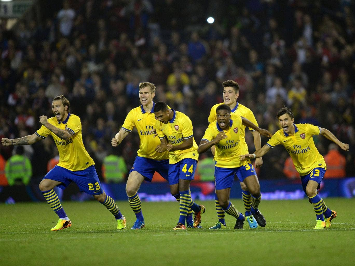 Arsenal's young side celebrate their penalties win over West Bromwich Albion