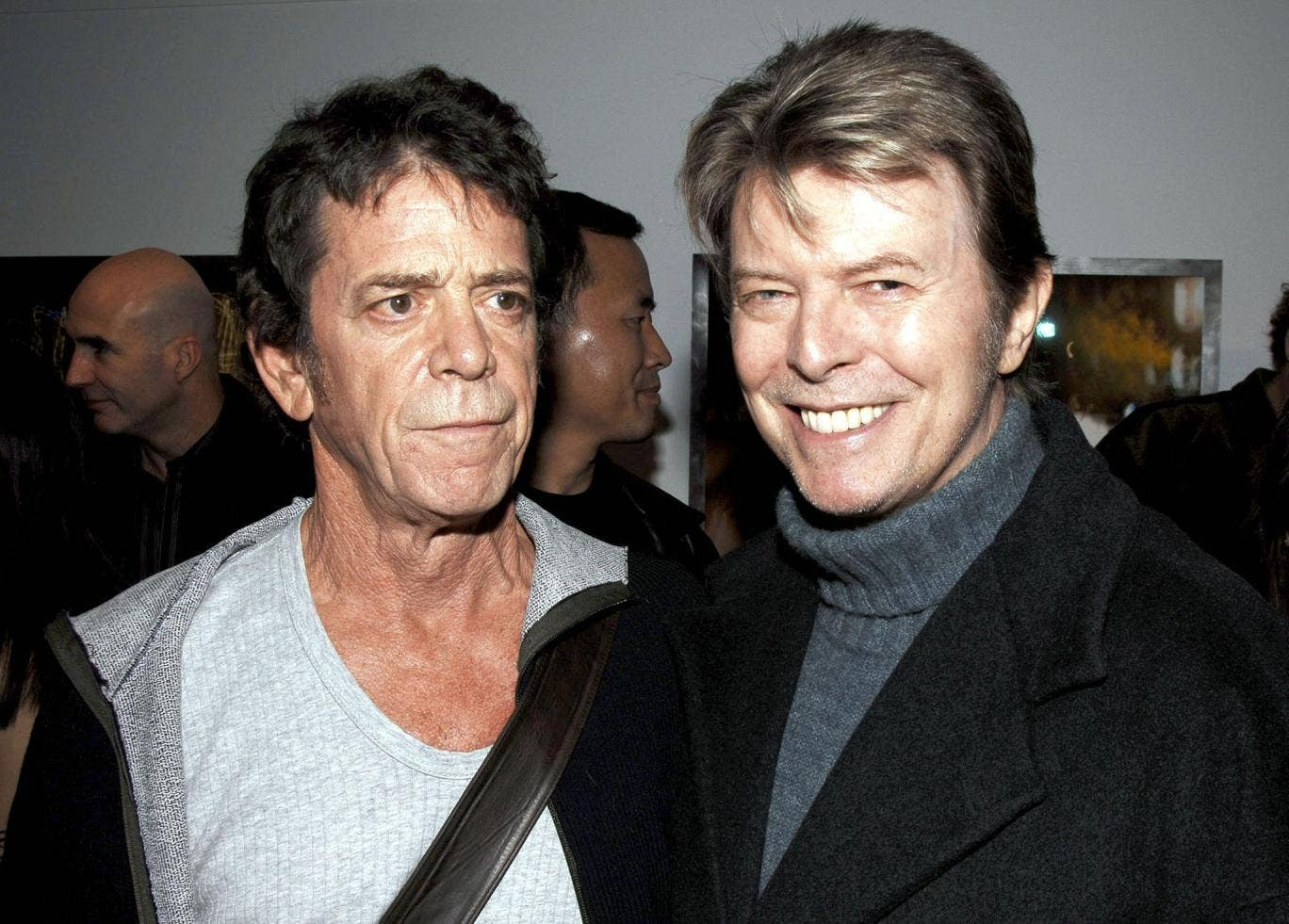 Lou Reed and David Bowie attend the opening of  Reed's photography exhibition in New York City, 2006.