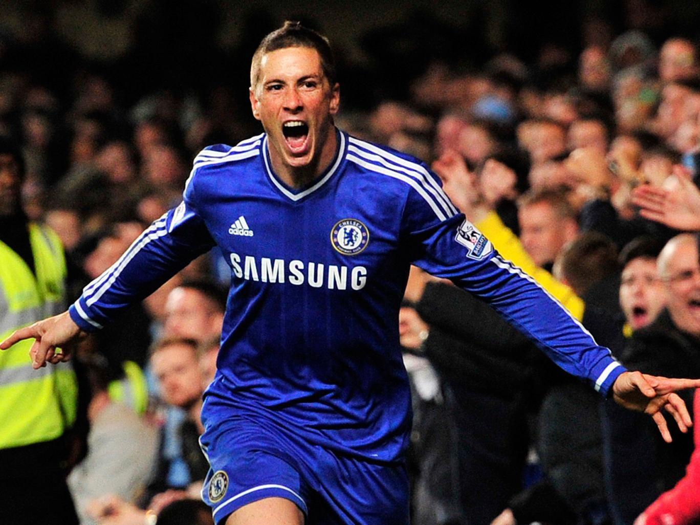 Fernando Torres celebrates scoring the winning goal for Chelsea against Manchester City
