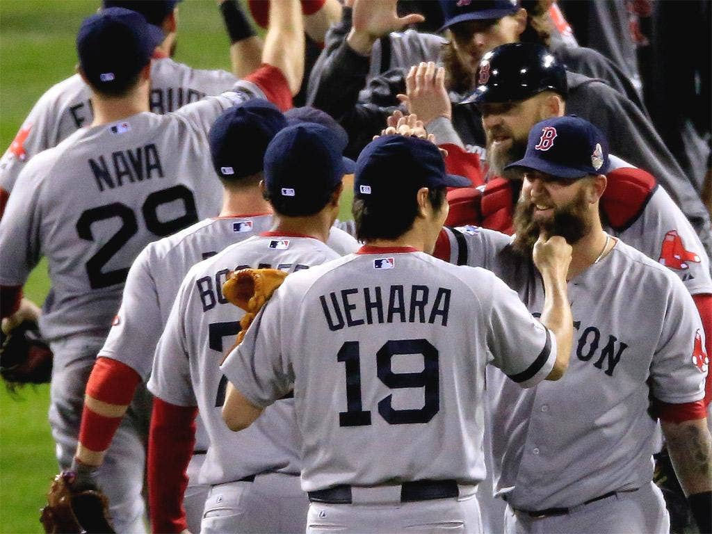 The bearded Boston Red Sox players celebrate victory in Game Five of the World Series