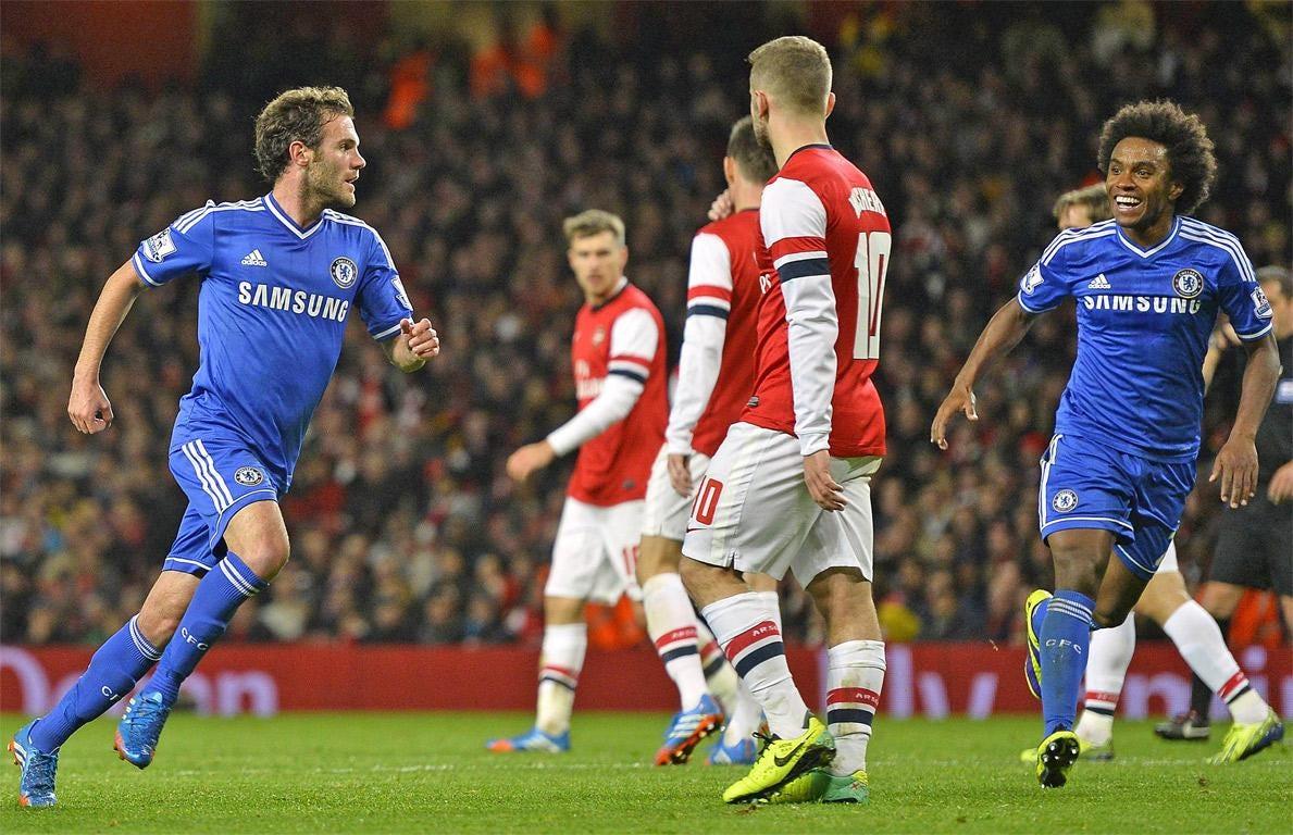 Juan Mata wheels away after scoring Chelsea's second goal