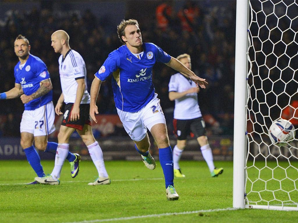 Ignasi Miquel, on loan from Arsenal, celebrates scoring Leicester's third