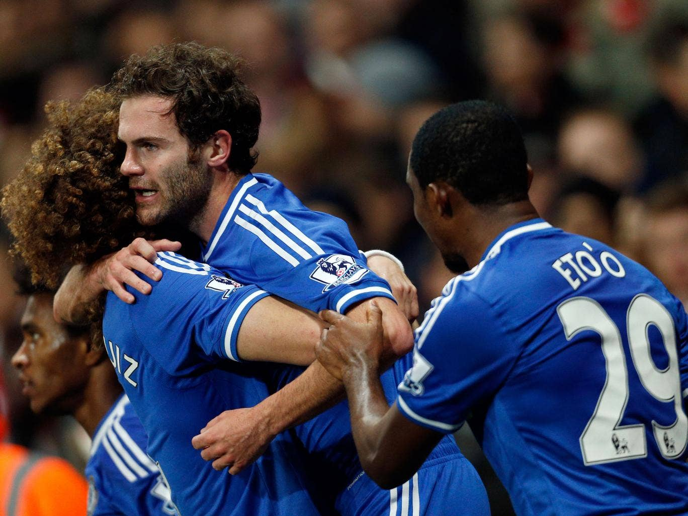 Chelsea's Spanish midfielder Juan Mata (C) celebrates scoring their second goal