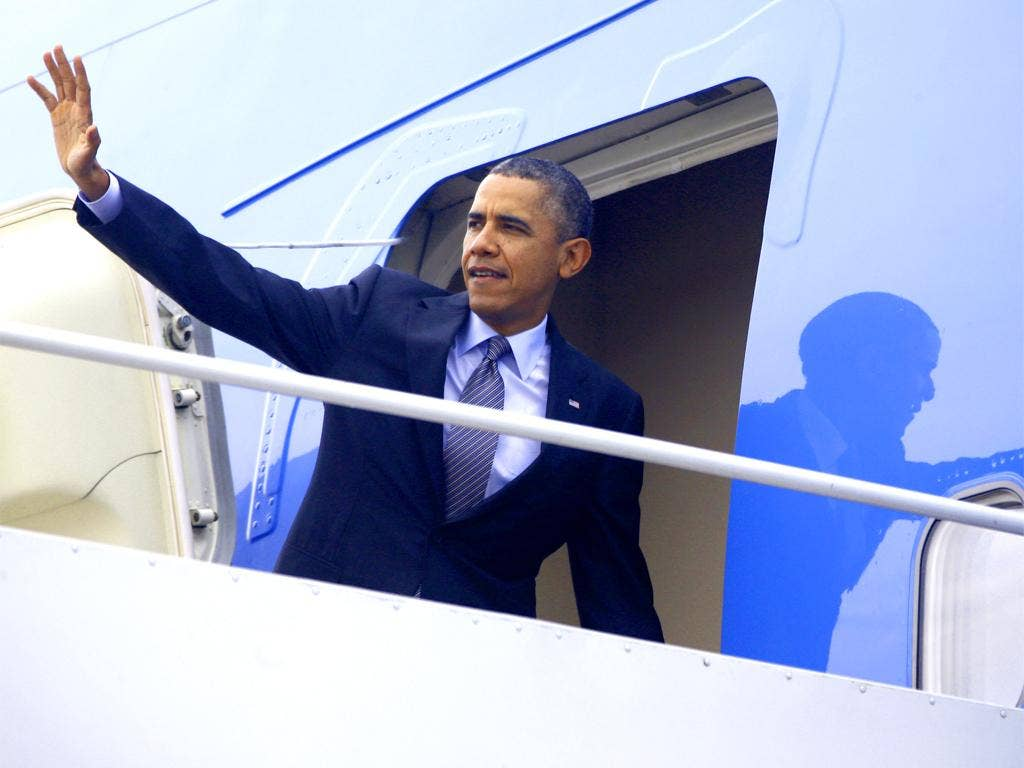 Reforms in jeopardy: Barack Obama waves as he boards Air Force One on his way to Boston