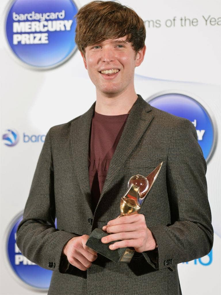 British singer-songwriter and producer James Blake poses with the Mercury Prize trophy