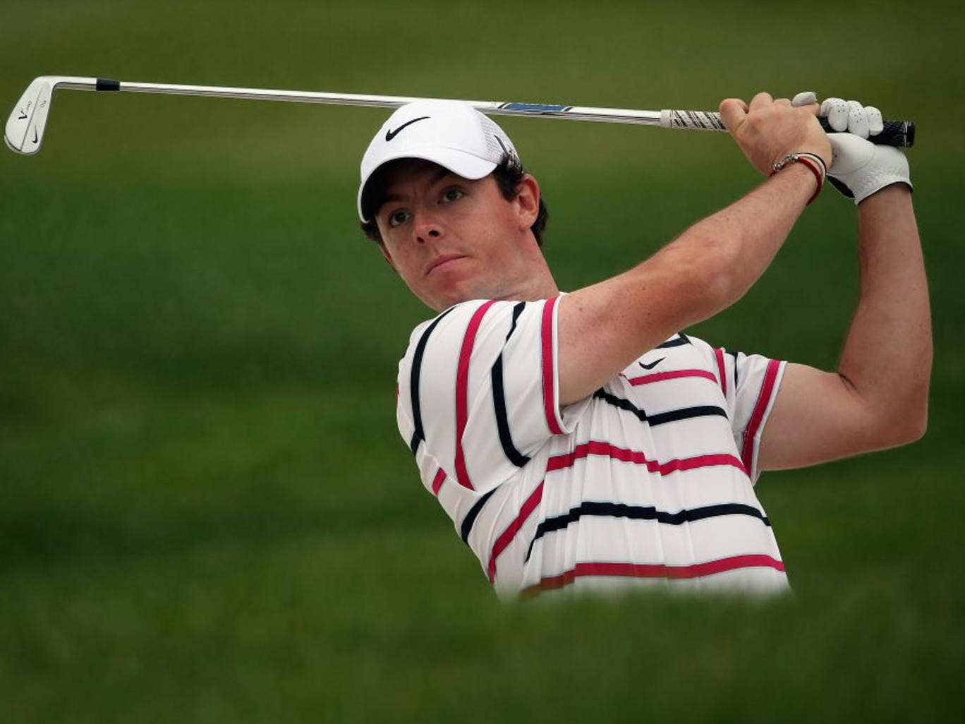 Rory McIlroy hits his second shot on the ninth hole during the first round in Shanghai