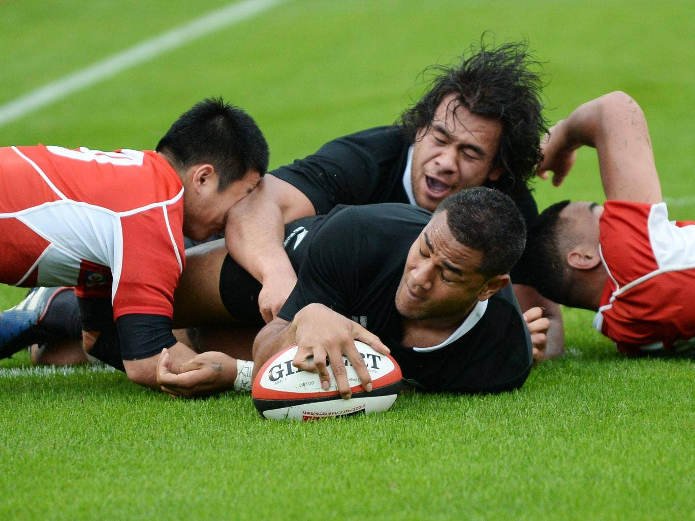 New Zealand's Frank Halai reaches out to score a try against Japan