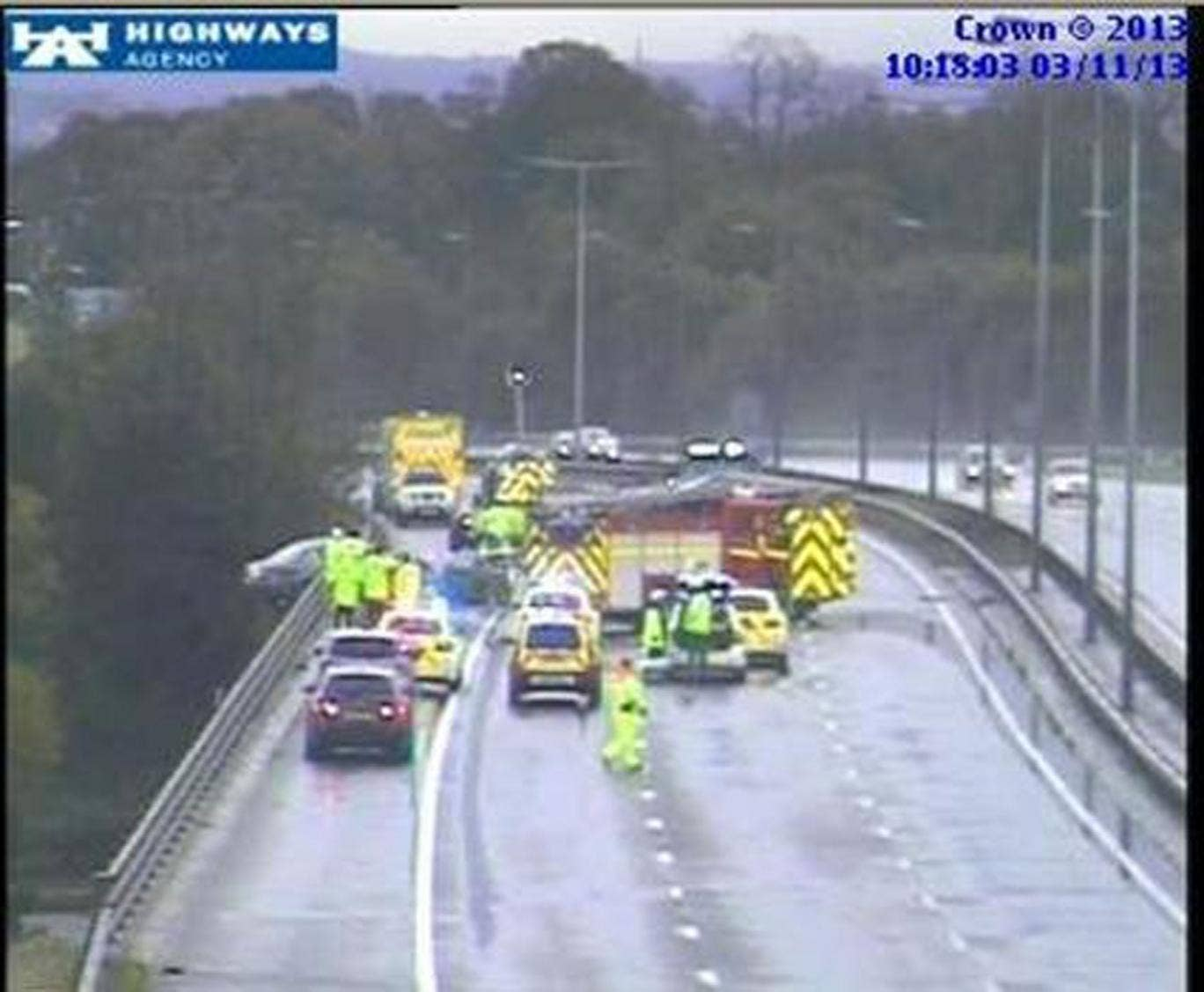 Dramatic images from the Highways Agency show the vehicle teetering over the edge of the M6 carriageway at junction 23, near Haydock.