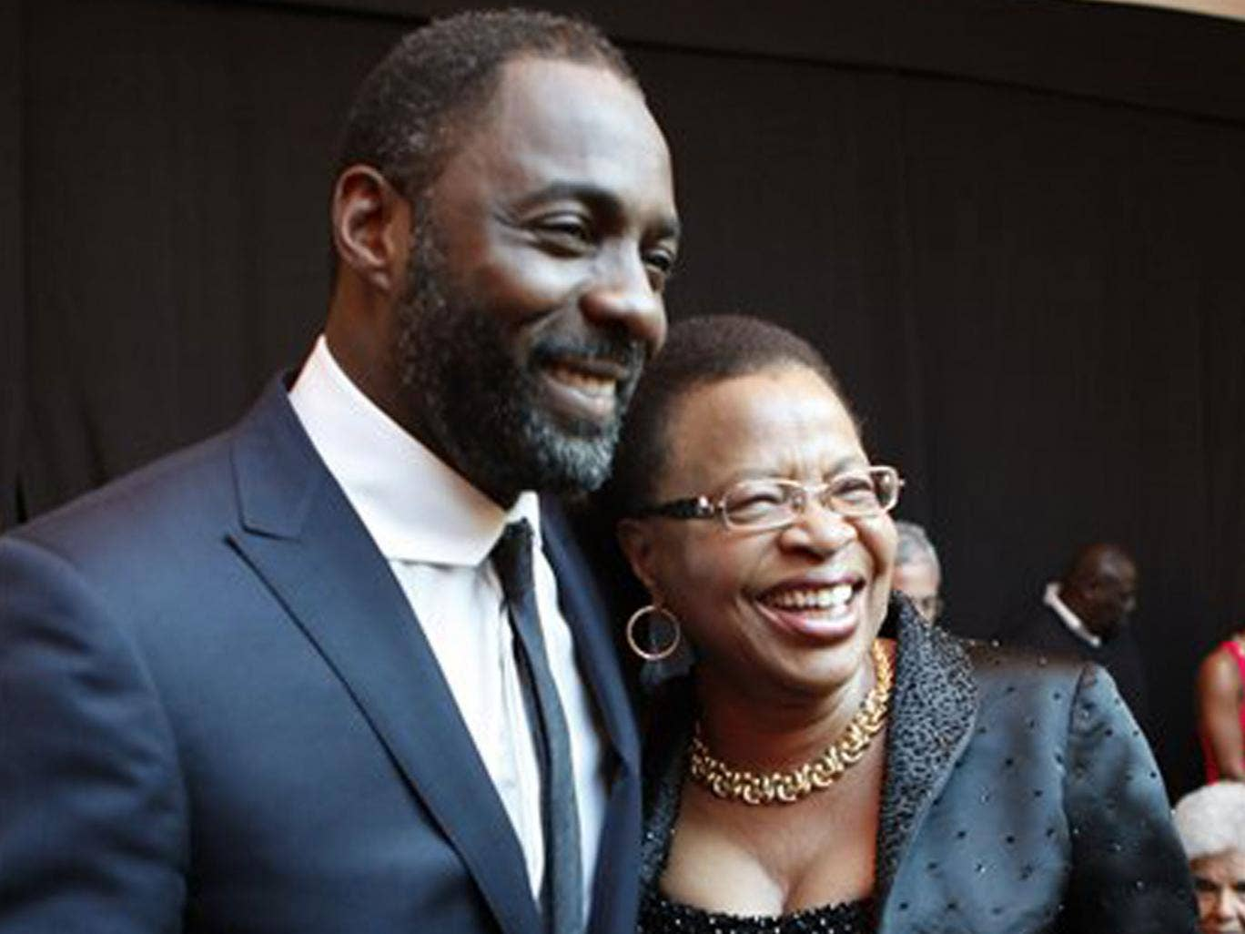 Idris Elba with Graca Machel, the wife of former South African President Nelson Mandela, at the premiere of Mandela: Long Walk to Freedom in Johannesburg