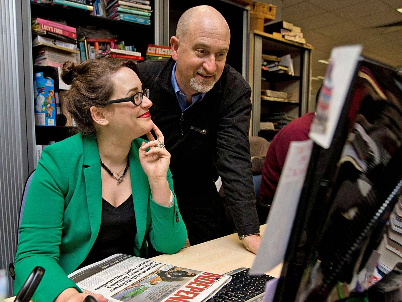 Father's day: Independent features editor Rebecca Armstrong shows her dad Mike what she does during a day's work