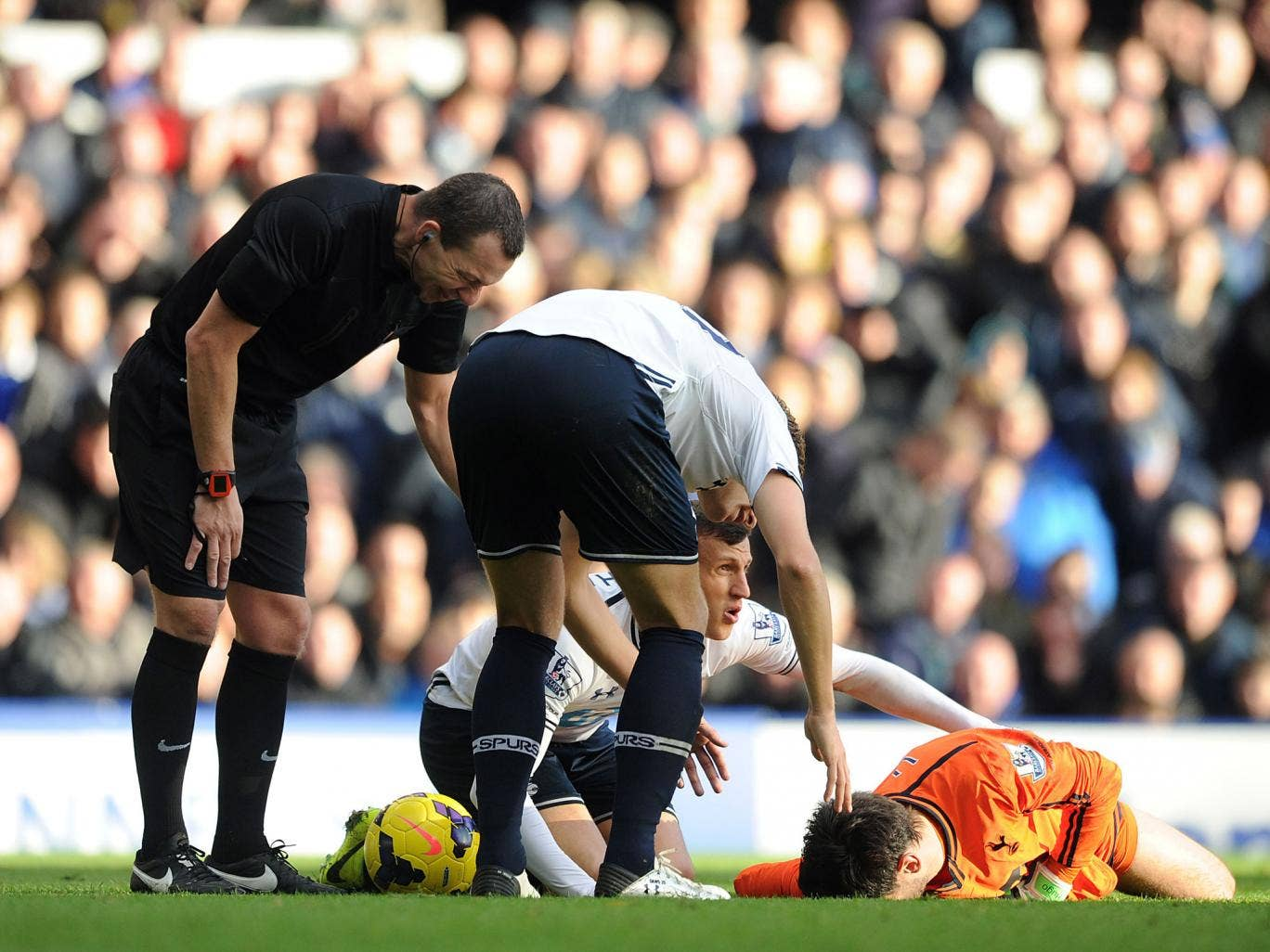 Lloris' (in orange) collision with Romelu Lukaku visibly left the Frenchman unconscious for a short time