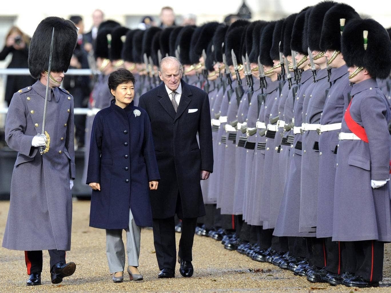 South Korean President Park Geun-hye is accompanied by Prince Philip at Horse Guards Parade in London