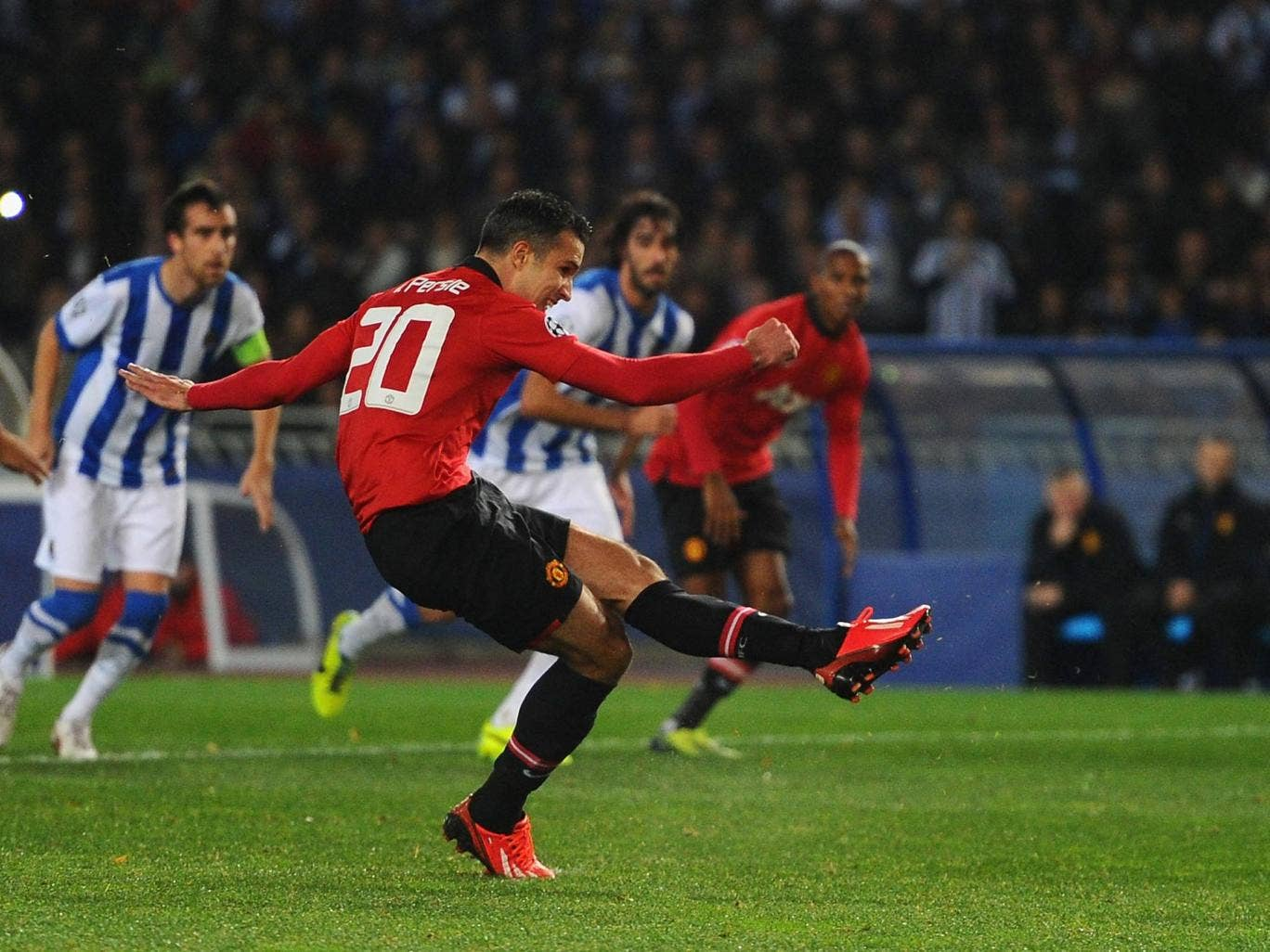 Ashley Young watches on as Robin van Persie hits the post from the penalty spot