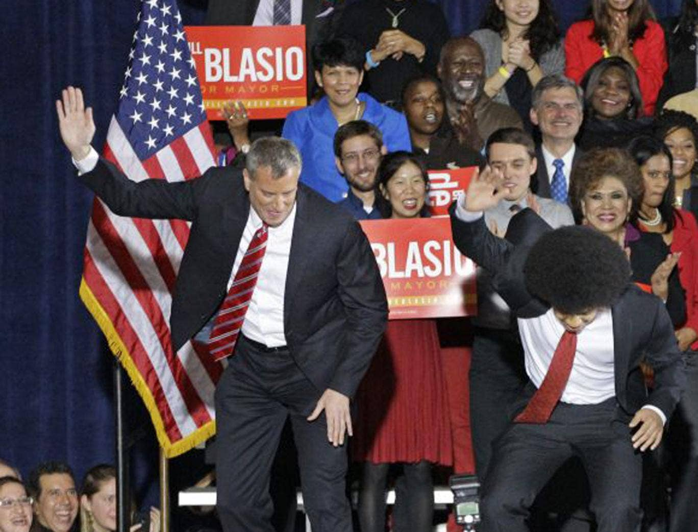 """Supporters watch as Democratic mayor-elect Bill de Blasio and his son Dante perform the family's """"smack down"""" dance on stage after de Blasio was elected mayorof New York City on November 5th"""