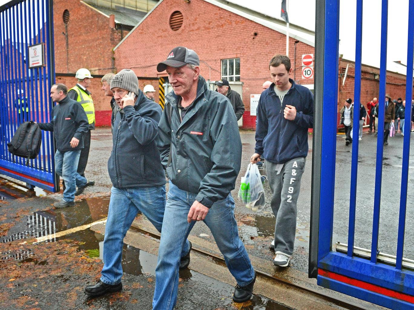 Shipyard workers leave the BAE systems yard in Govan following the announcement that the company will be cutting jobs
