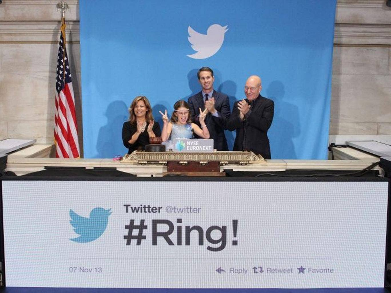 British actor Sir Patrick Stewart (R), flanked by Vivienne Harr (2-L), Boston police officer Cheryl Fiandaca (L) and Twitter co-founder Evan Williams (2-R) at the ringing of the opening bell to mark Twitter's highly anticipated initial public offering (IP
