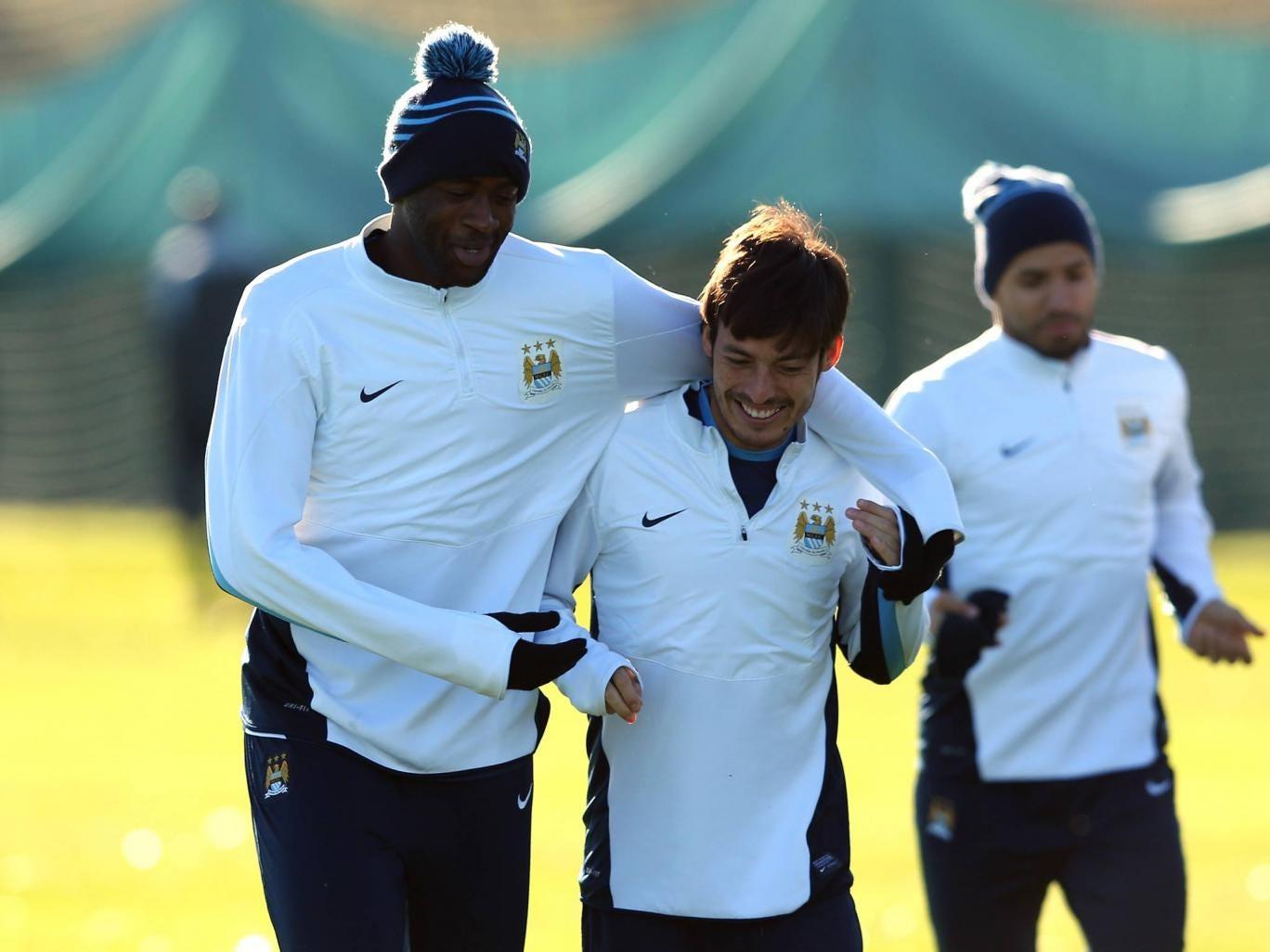 David Silva with Yaya Toure in training