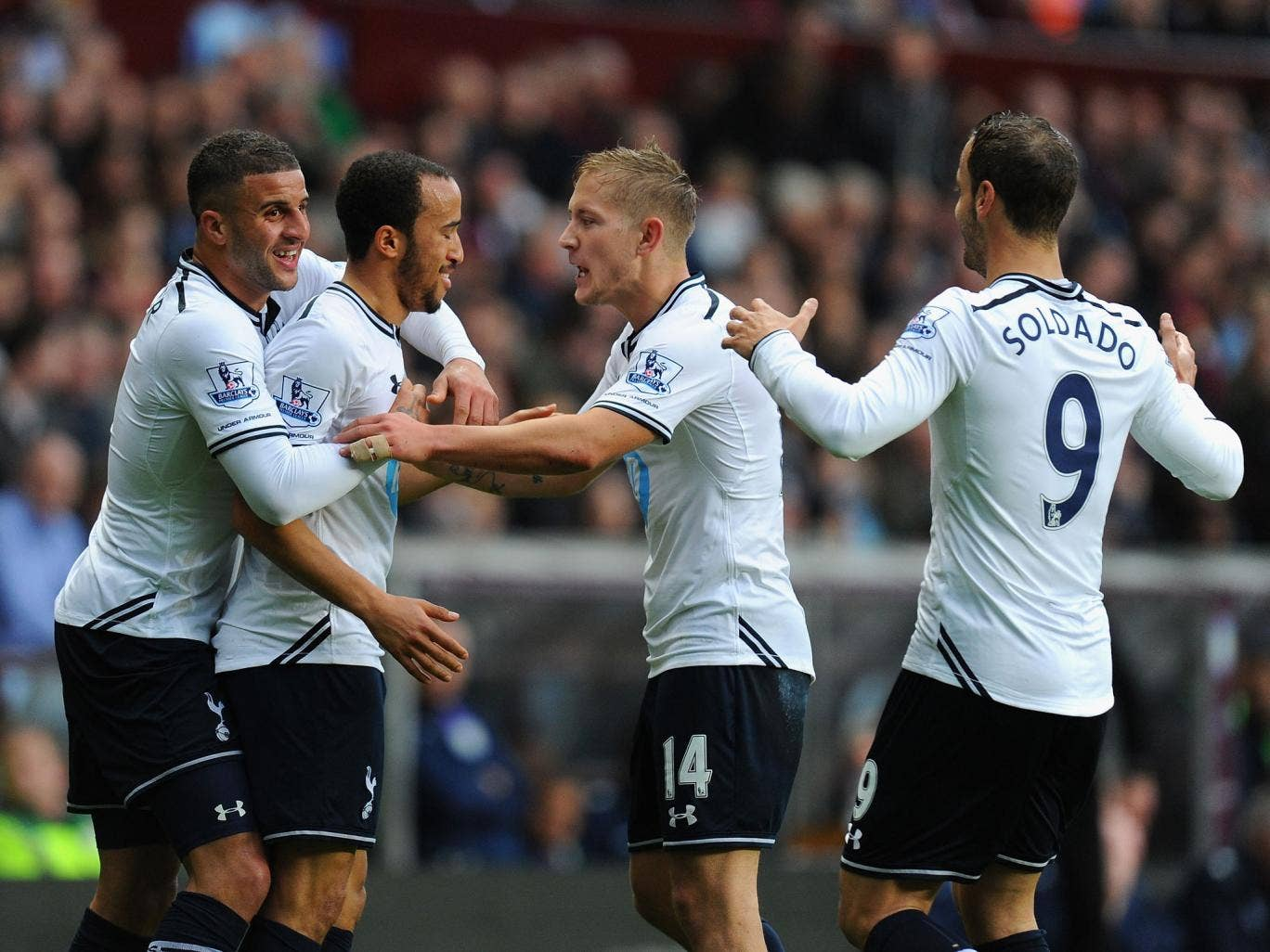 Andros Townsend celebrates with Tottenham team-mates Kyle Walker, Lewis Holtby and Roberto Soldado