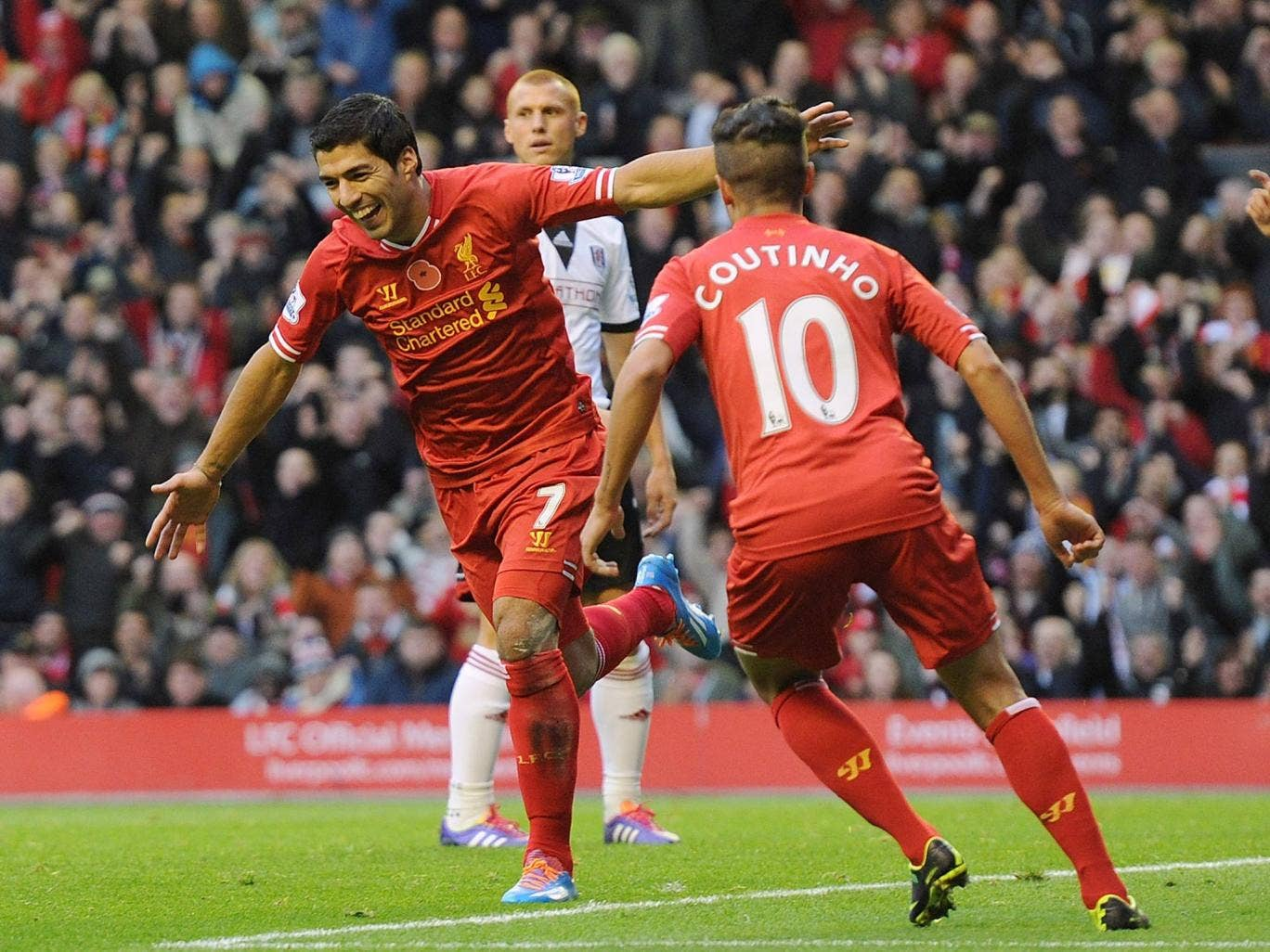 Luis Suarez of Liverpool celebrates his first goal