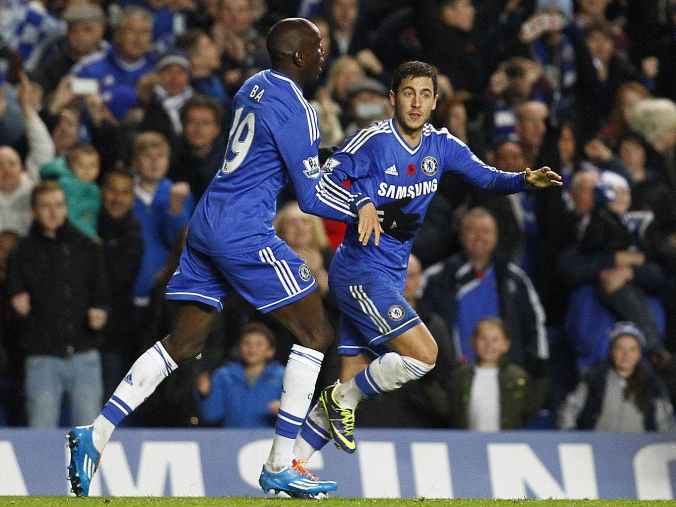 Eden Hazard of Chelsea celebrates with team mate Demba Ba after scoring the equaliser