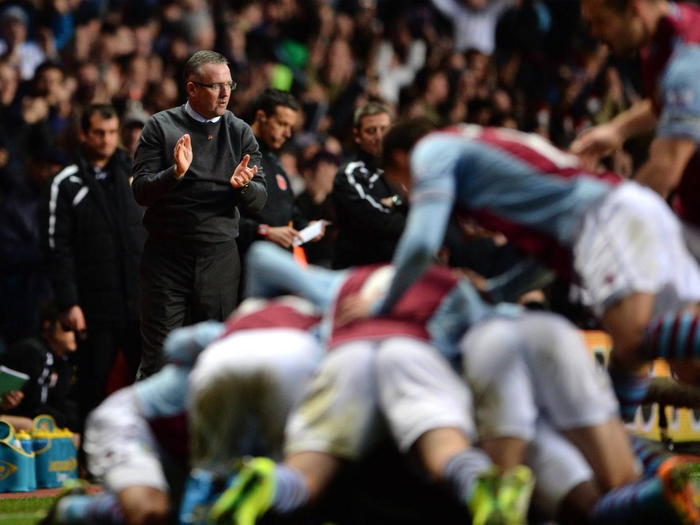 Paul Lambert the Aston Villa manager applauds his players following Leandro Bacuna of Aston Villa opening goal