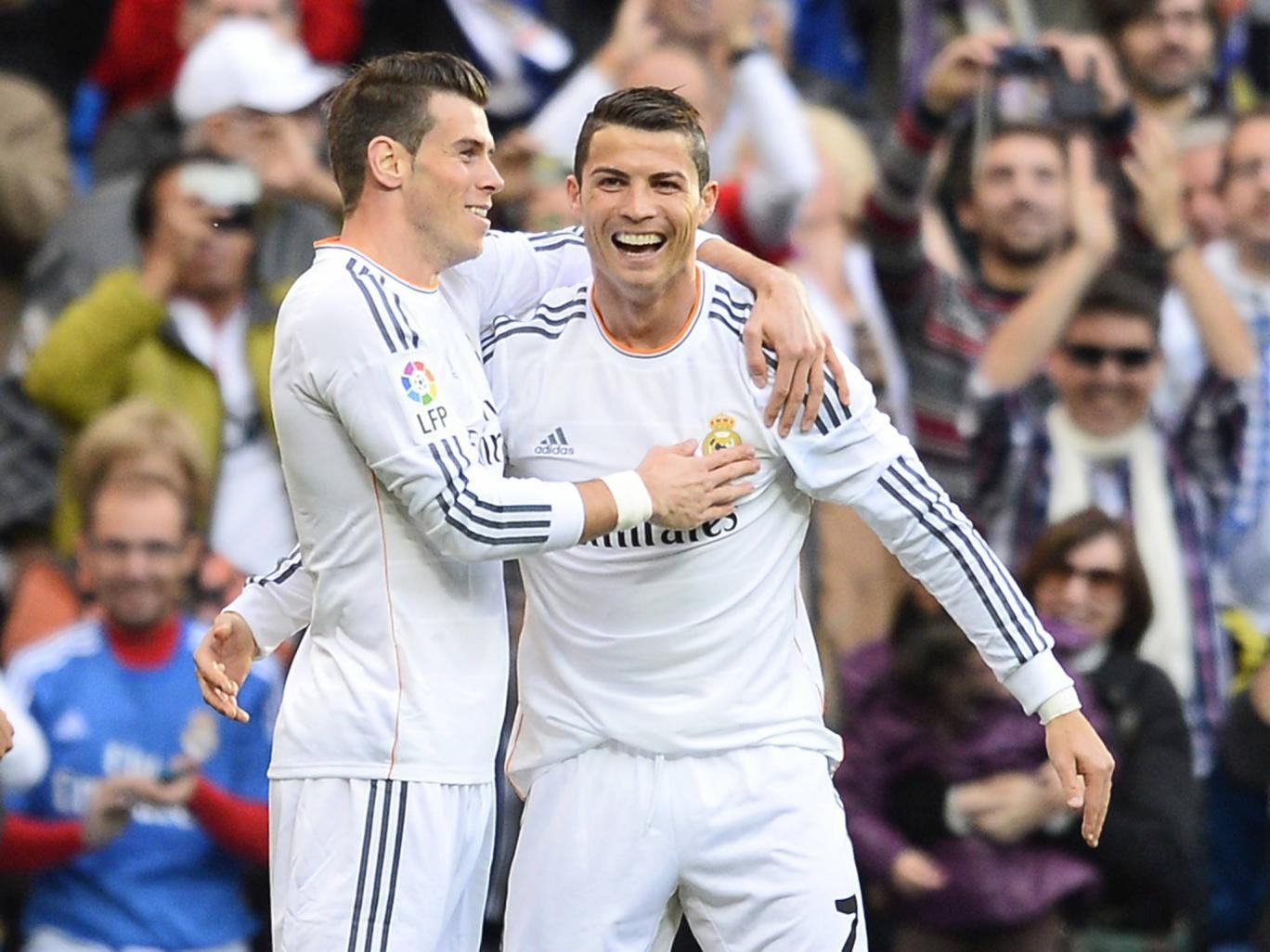 Real Madrid's Portuguese forward Cristiano Ronaldo (R) celebrates with Real Madrid's Welsh striker Gareth Bale
