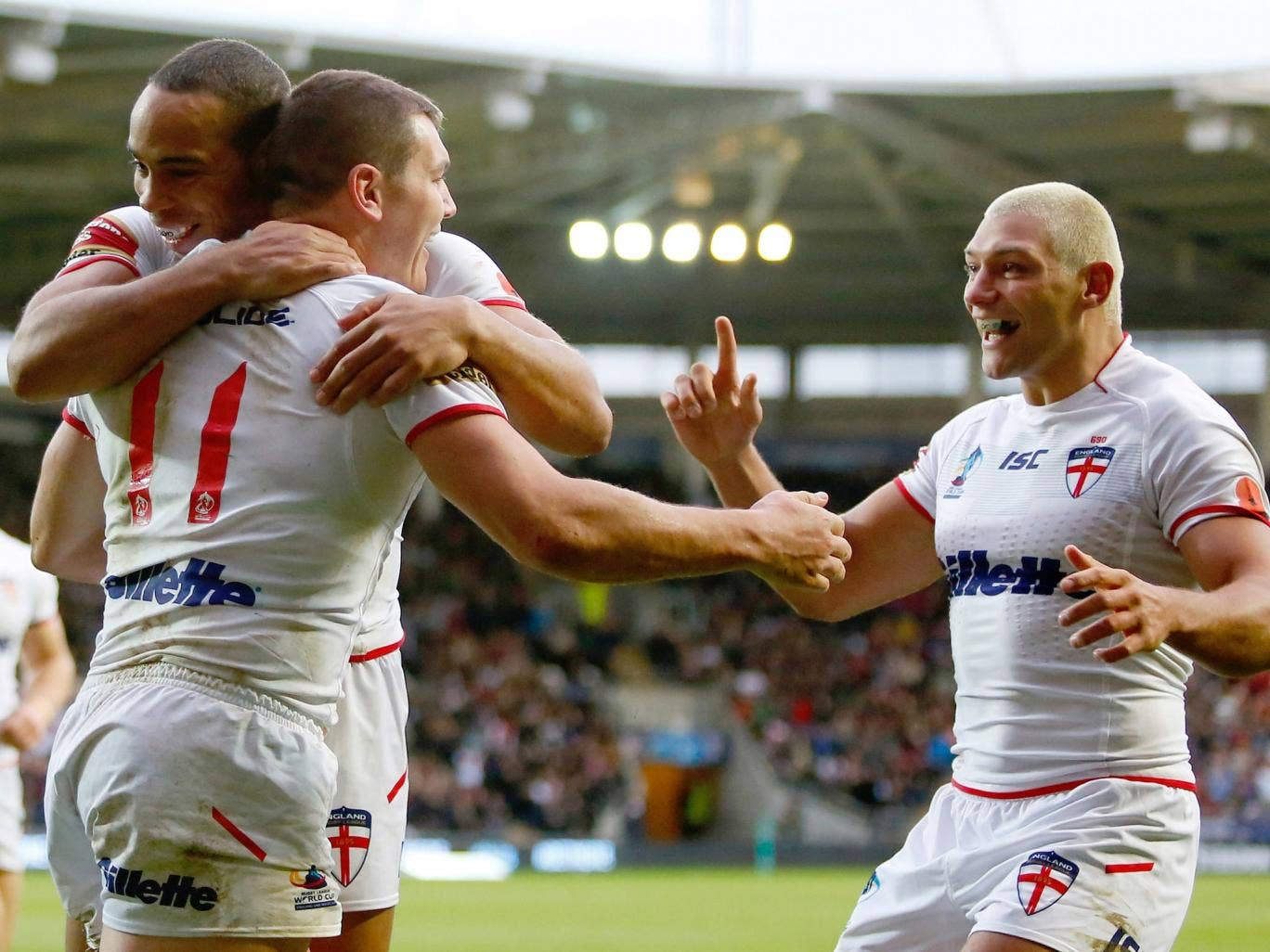 Brett Ferres (C) of England celebrates his try with team mates Leroy Cudjoe (L) and Ryan Hall during the Rugby League World Cup Group A match against Fiji