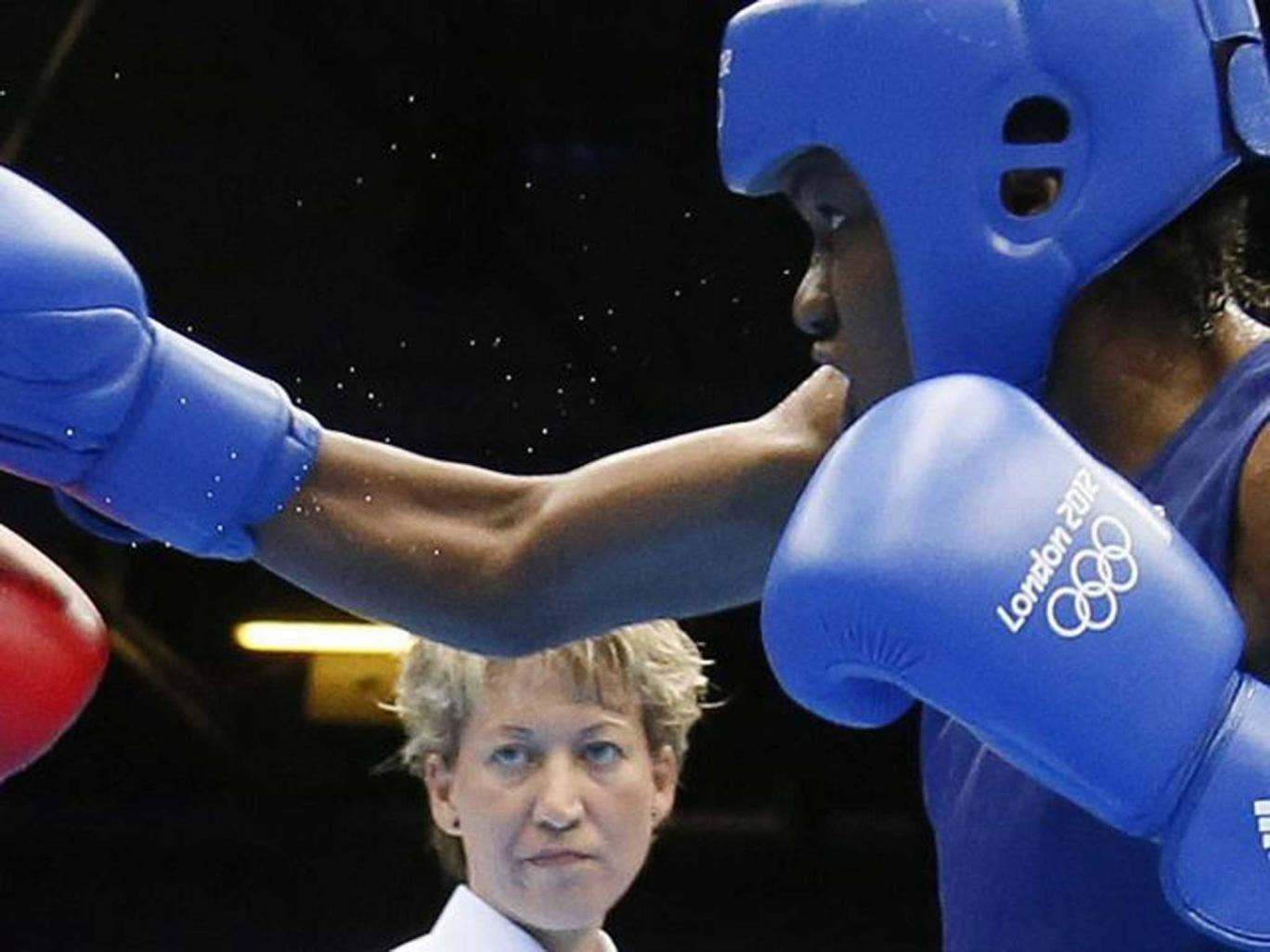 Team GB's Nicola Adams on her way to the flyweight gold medal against Cancan Ren of China during London 2012