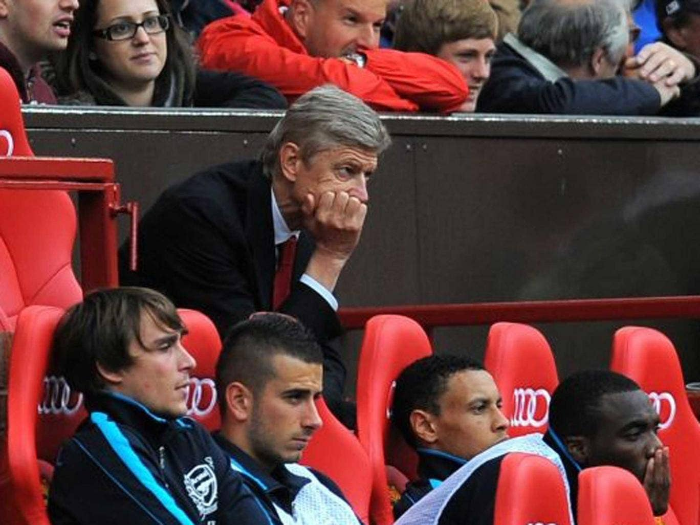 Score to settle: Wenger sees his team taken apart at Old Trafford in 2011 but returns today in a position of strength