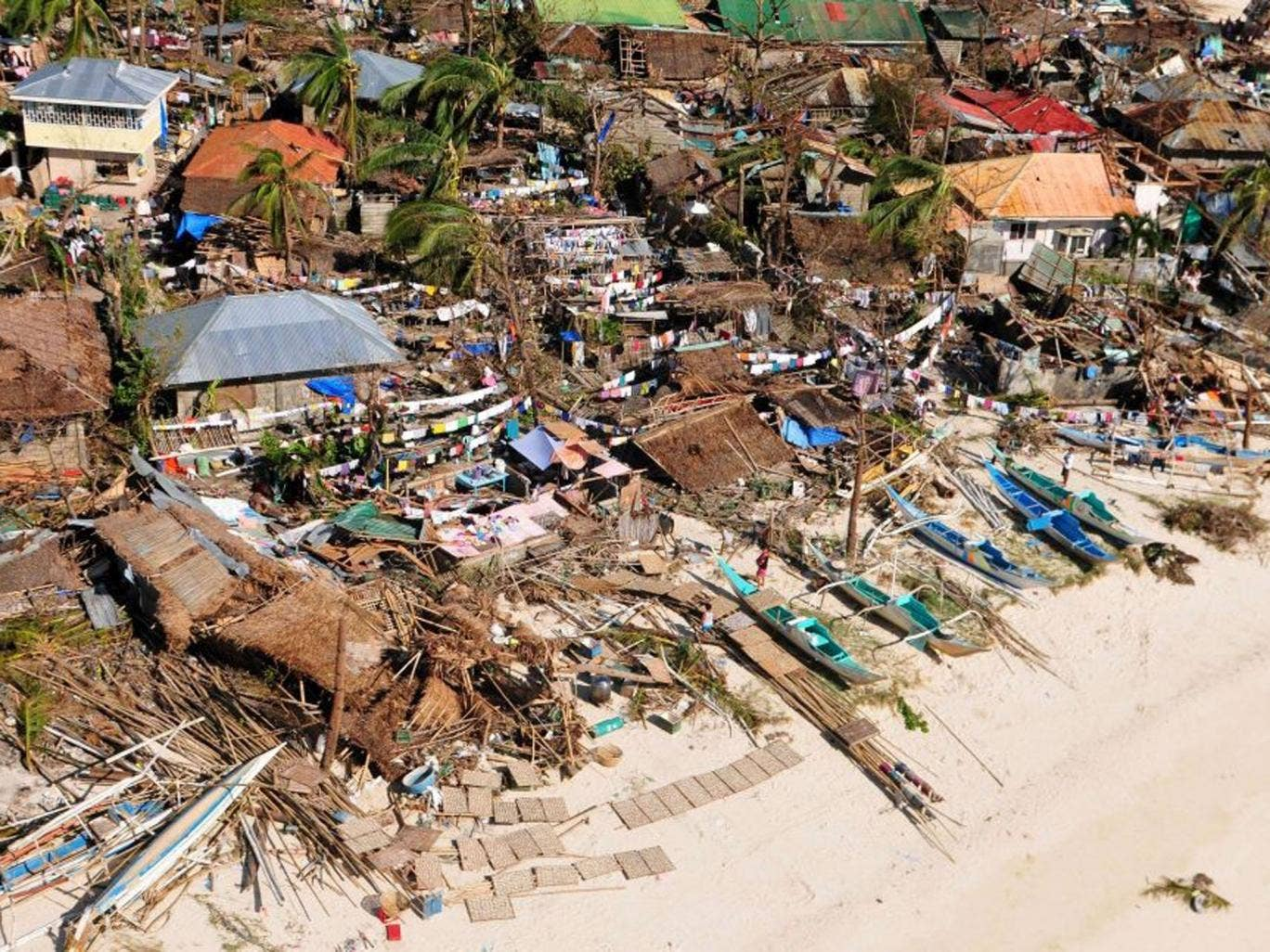 Devastation: The scene in Tacloban in central Philippines after it was hit by Haiyan