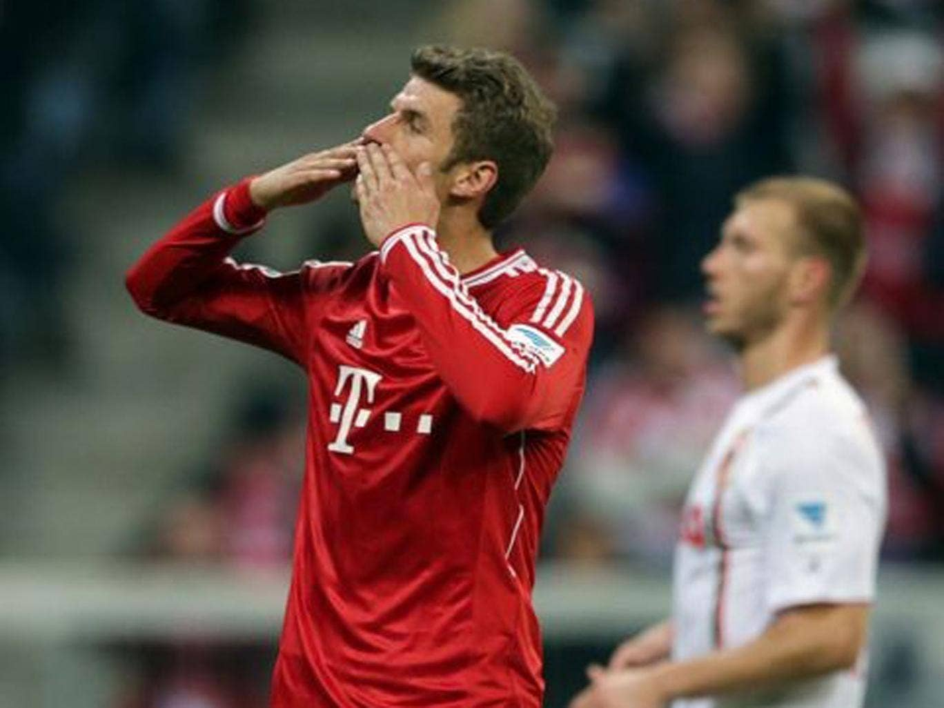 Bayern's Thomas Mueller celebrates after scoring a penalty during the German first division Bundesliga match between FC Bayern Munich and FC Augsburg