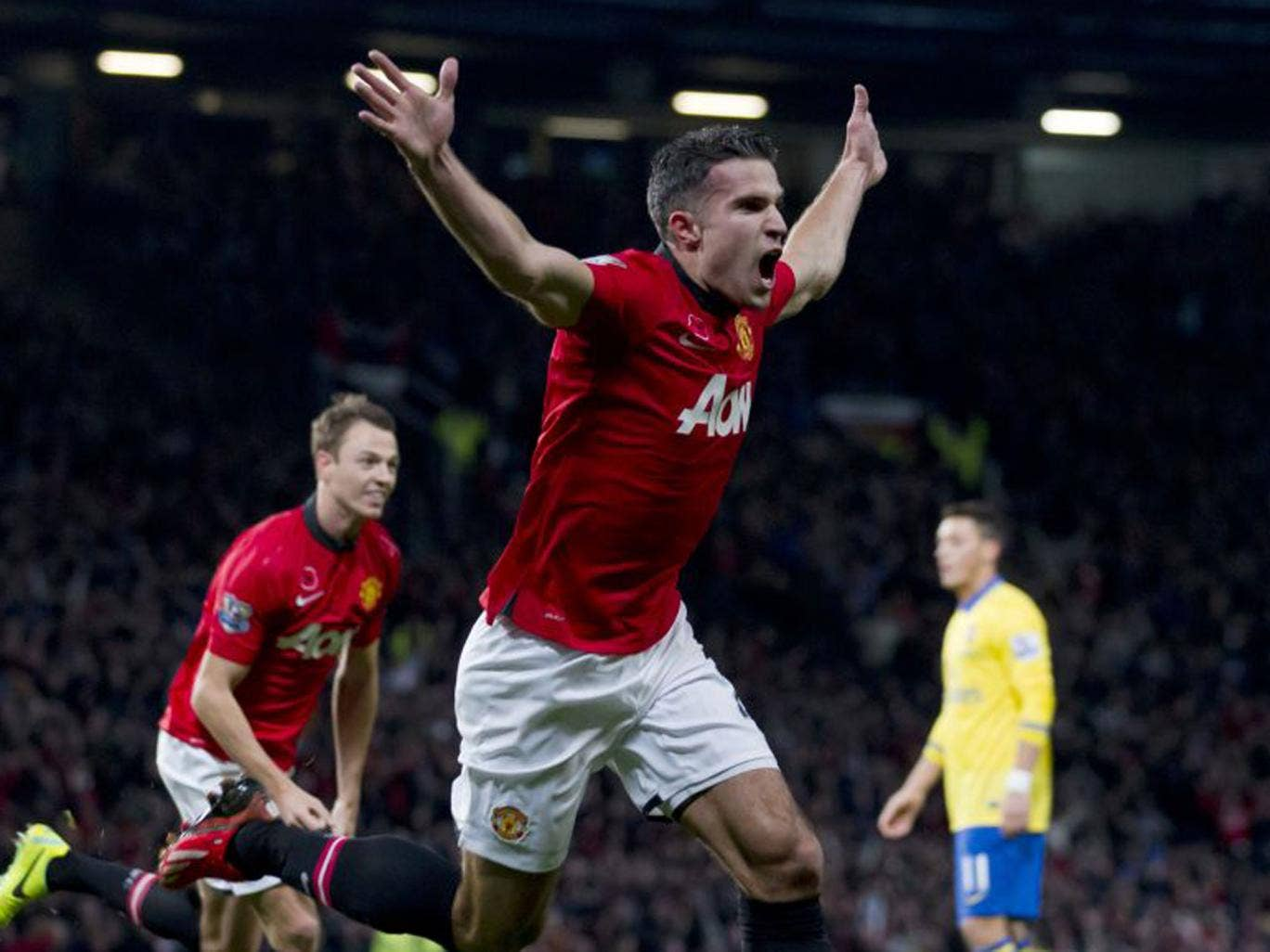 Robin van Persie celebrates the only goal of the game against his former team