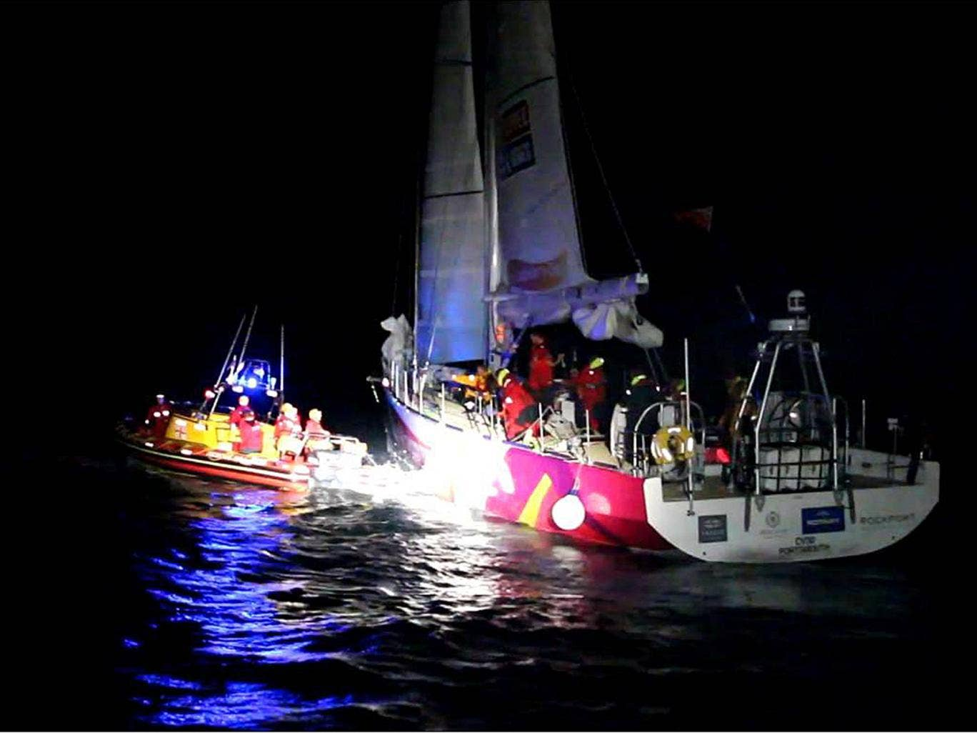 British woman Michelle Porter 37, from London, being transferred to a rescue craft because of an injury when her yacht, one of 12 taking part in the Clipper round-the-world race, was hit by a 'monumental' wave off the coast of South Africa and who has bee