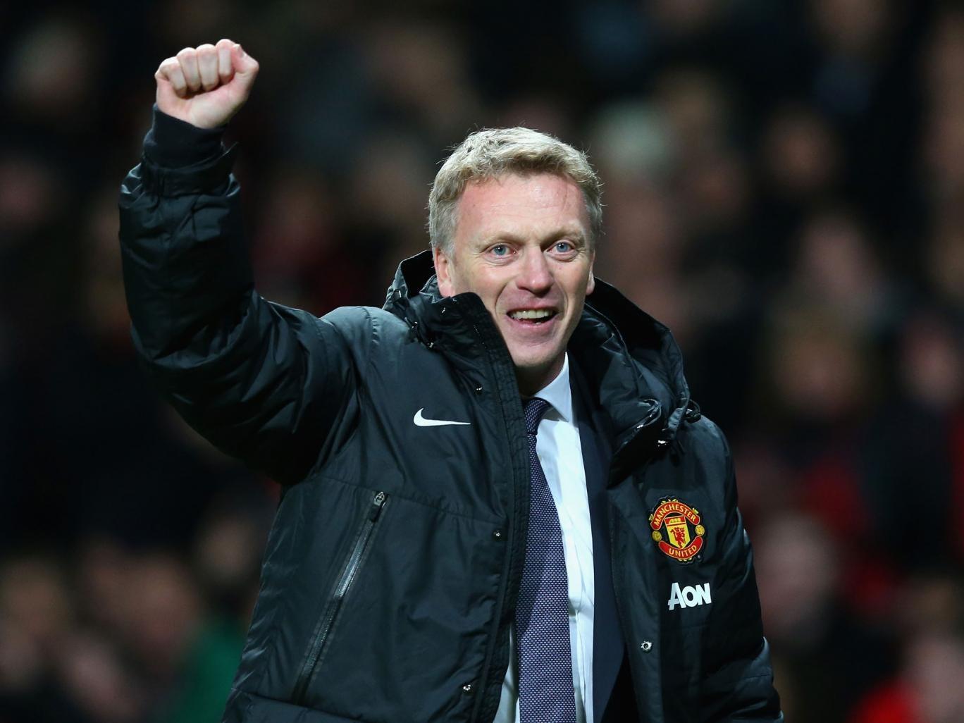 Manchester United manager David Moyes celebrates victory over Arsenal