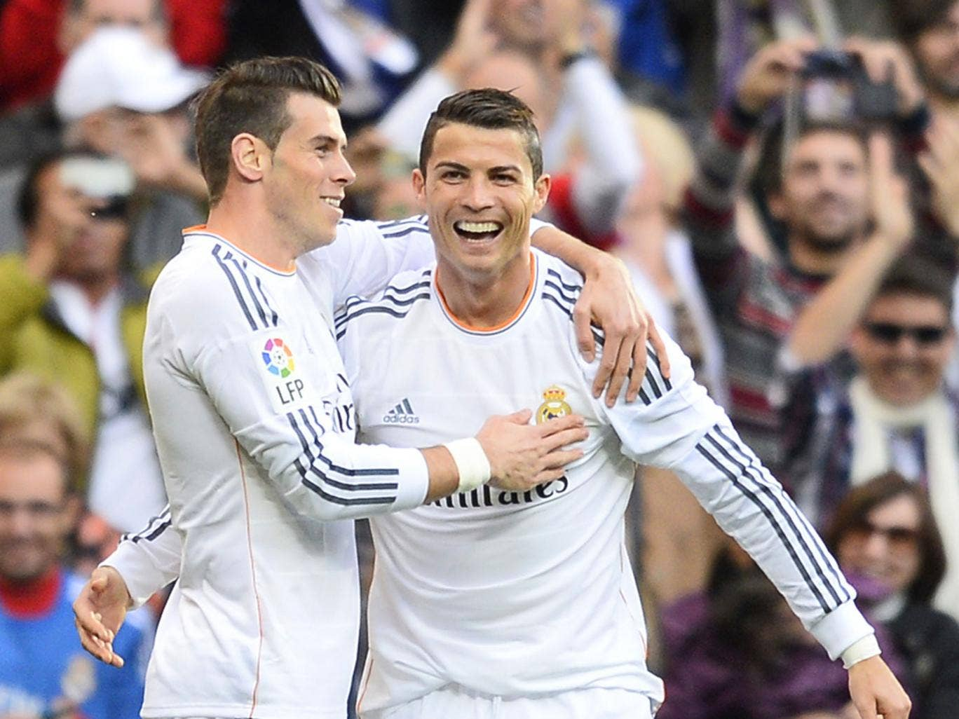 Cristiano Ronaldo (right) celebrates his first goal in the 5-1 win over Real Sociedad with Gareth Bale on Saturday