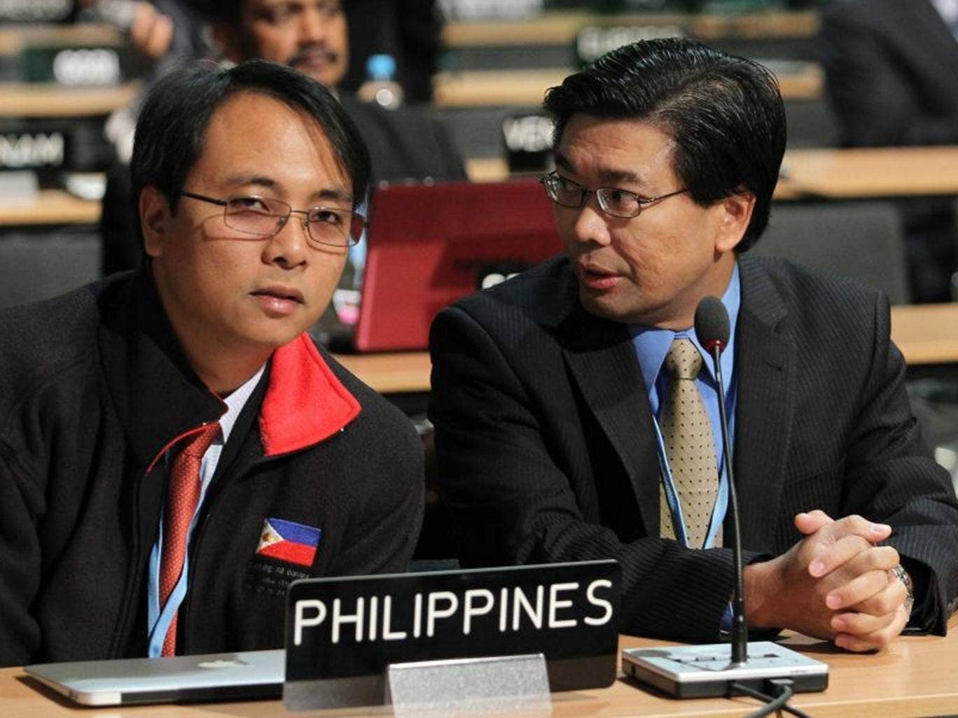 Filipino delegates Naderev Sano, left, and Vicente Paolo Yu III