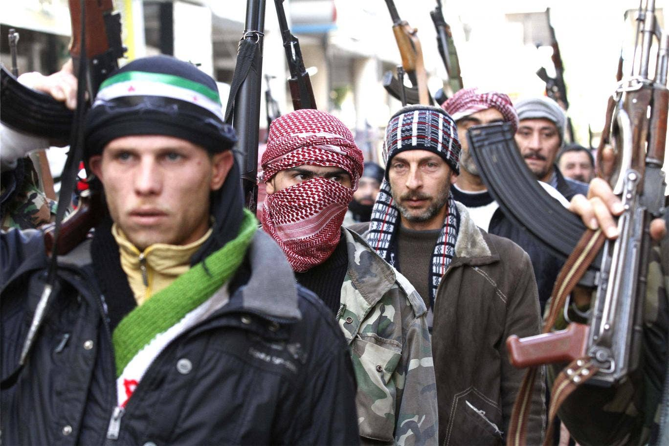 Pero joined the ranks of the Syrian rebels, here shown in Idlib, Syria last year