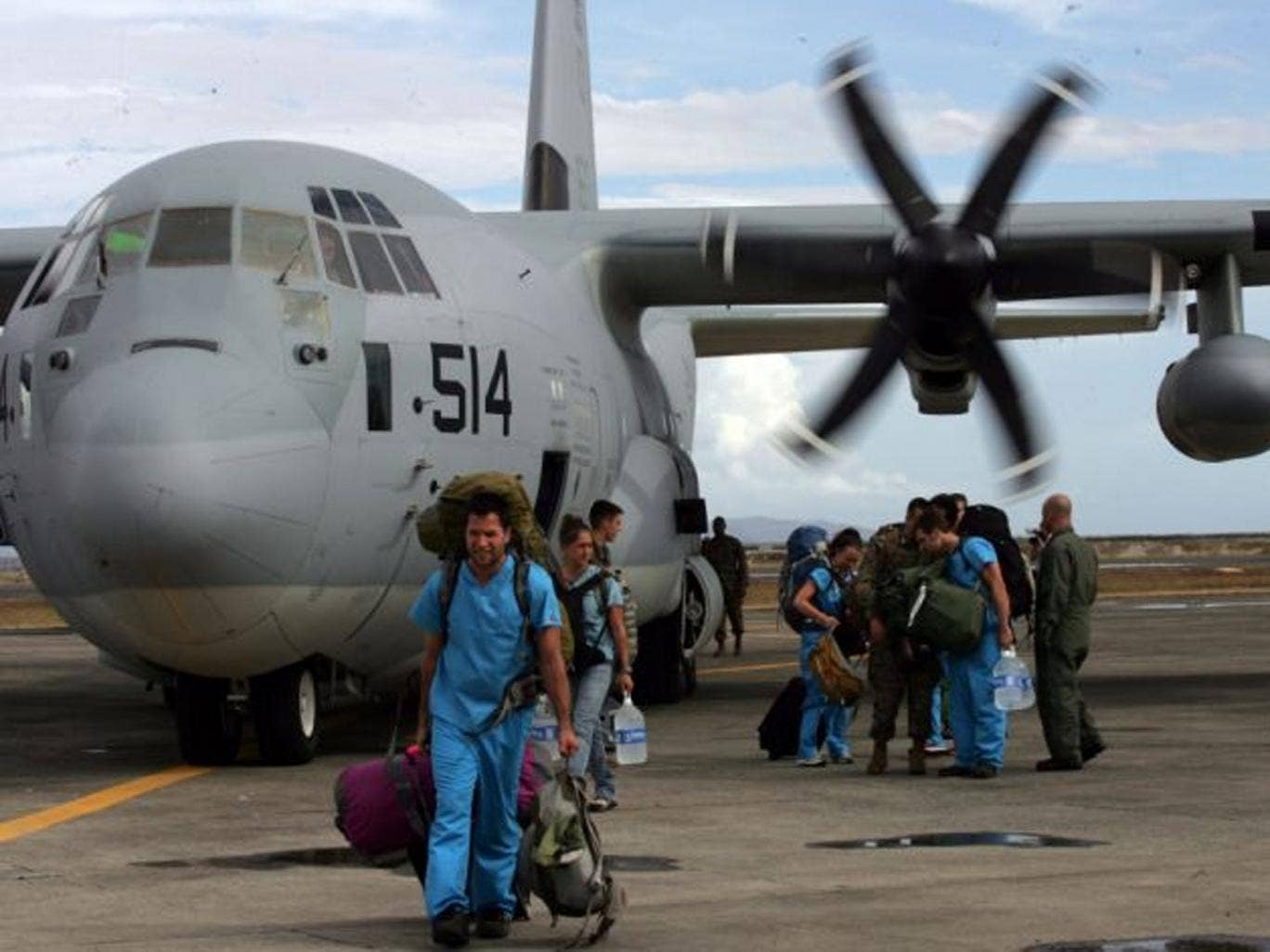 Foreign doctors on board a US C-130 plane arrive to help people affected by typhoon in Tacloban, Leyte, Philippines