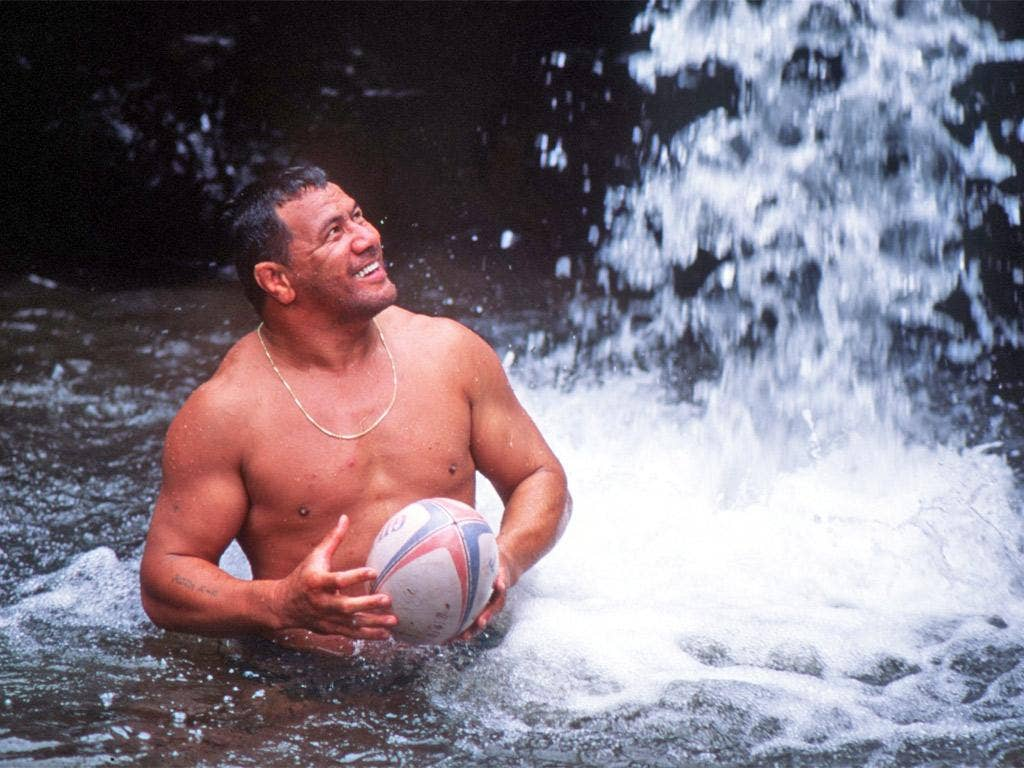 Fatialofa cools off under a waterfall in the run-up to a game against a touring Wales side in 1994