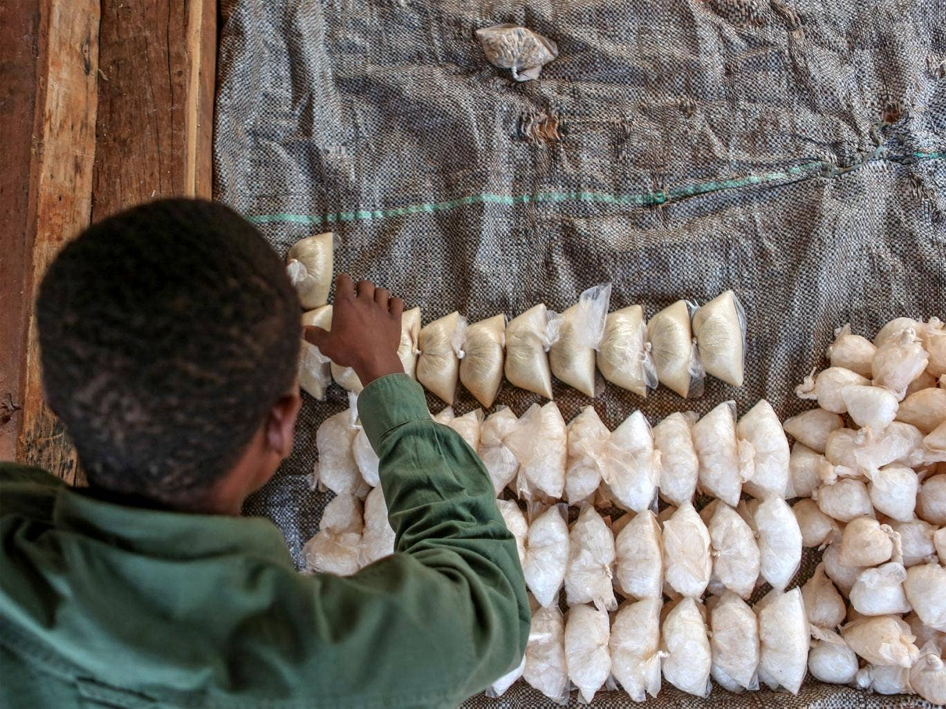 Conflict victim Abdul Kareem, 16, has a new life running his market stall thanks to Unicef support