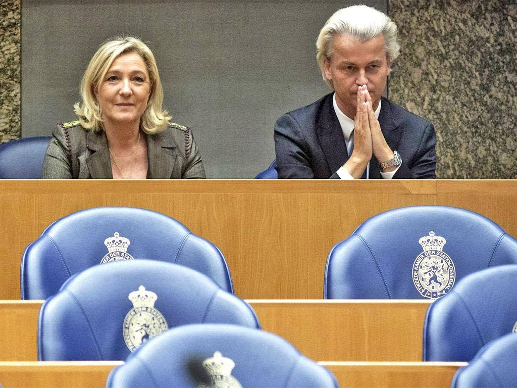 Marine Le Pen, leader of the French National Front, sits next to Dutch leader of the Party for Freedom (PVV) Geert Wilders, at The Hague