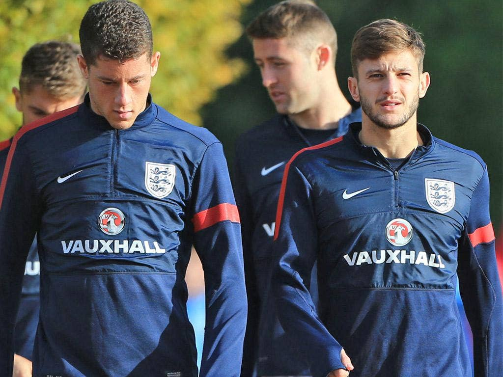 Ross Barkley (left) walks with Adam Lallana during training at London Colney