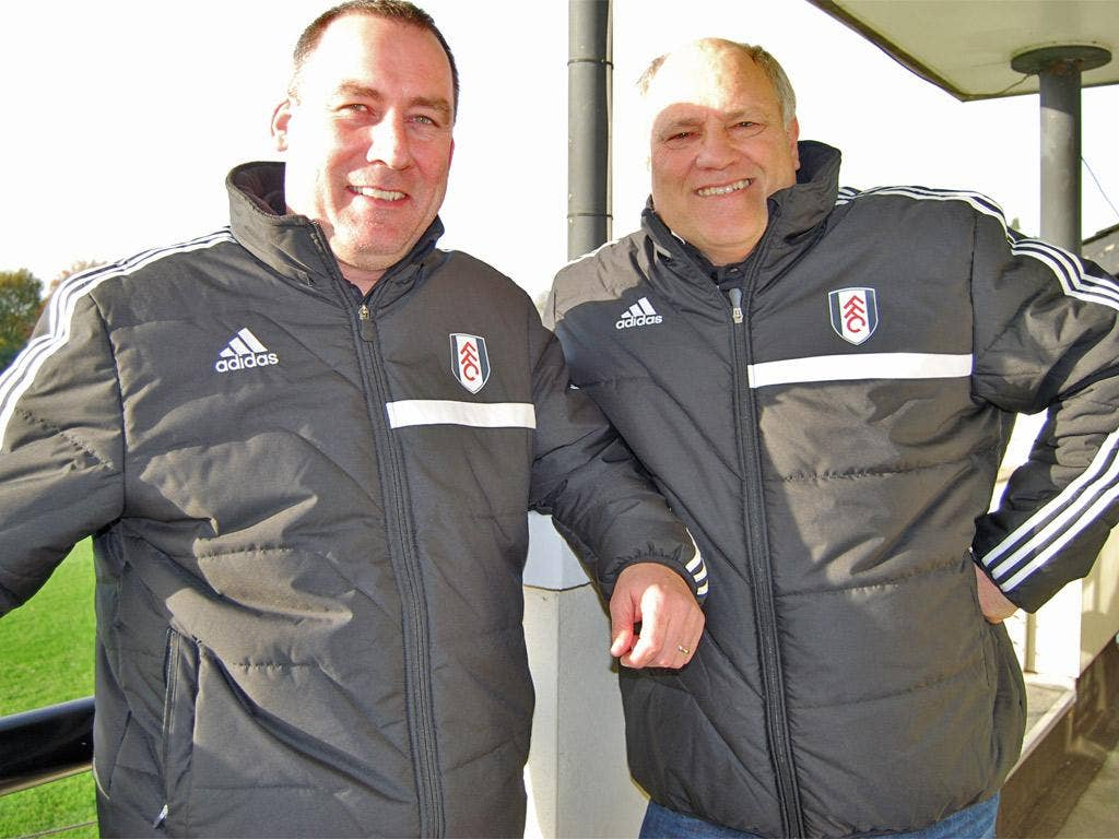 New head coach Rene Meulensteen (left) with fellow Dutchman Martin Jol at Fulham's training ground