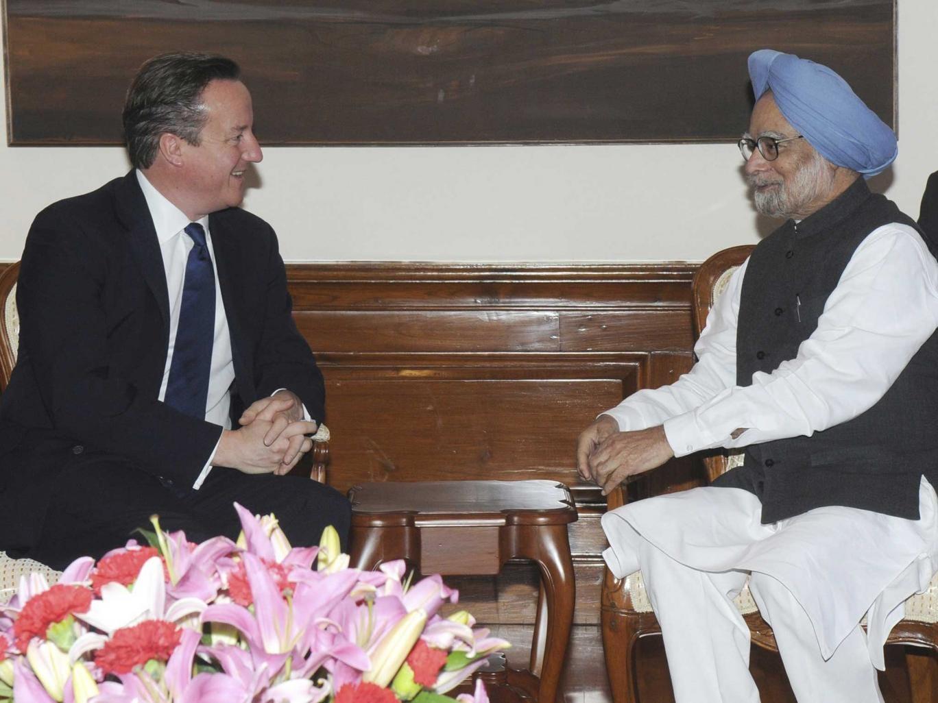 David Cameron speaks with India's Prime Minister Manmohan Singh in New Delhi