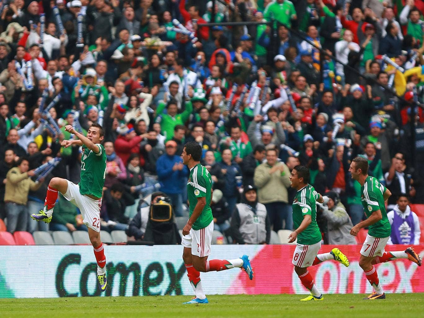 Paul Aguilar celebrates after scoring for Mexico against New Zealand in their 2014 World Cup play-off