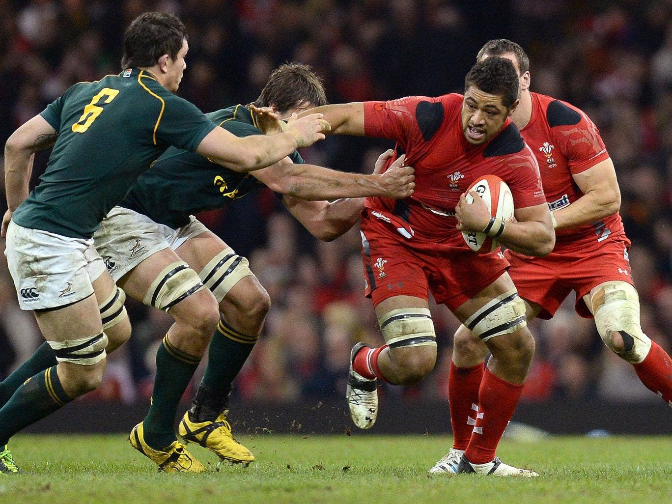 Wales Number Eight Toby Faletau attempts to break the tackle of the South African defence